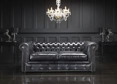 Furniture. Living Room With Black Leather Chesterfield Sectional Sofa And Black Wooden Wall Panel Also Antique Chandelier With Modern Sectional Sofa And Leather Chairs. Glamorous Leather Chesterfield Sectional For Living Room Furniture Interior Design