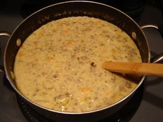 Cheeseburger Soup: 1 pound Ground Turkey or Beef; 3/4 c chopped onion; 3/4 c shredded carrot; 3/4 c chopped celery; 4 c diced potatoes (peeled or unpeeled); 1 t basil; 1 t parsley; 3 c chicken broth; 2 T melted butter; 1/4 c flour; 8 oz shredded cheese; 1 1/2 c milk; Salt and Pepper; 1/4 c sour cream, optional.