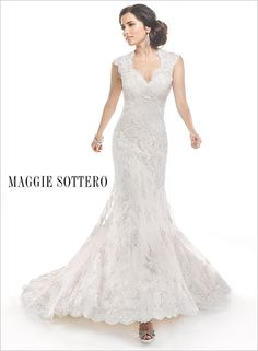 Maggie Sottero - Jessica Bridal Gown, very simple and classy.. I love the neckline and cut out back!