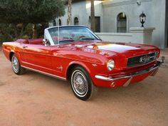 dream car.  1965 mustang convertible.  original pony interior, 4 speed, candy apple red, ragtop.