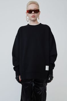 Acne Studios black loose-fitting crewneck sweatshirt with a fabric care label patch at the lower side. Acne Studios, Marketing Direct, Studio S, Crew Neck Sweatshirt, Knitwear, Sweatshirts, Shopping, Black, Women
