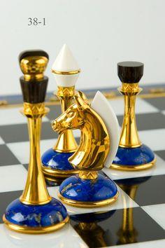 Chess pieces of lapis lazuli. Lapis lazuli /ˈlæpɪs ləˈzuːliː/, also /-ˈlæʒuːli/ or /-ˈlæʒuːlaɪ/, or lapis for short, is a deep blue semi-precious stone that has been prized since antiquity for its intense color. Chess Pieces, Game Pieces, Chess Set Unique, Chess Table, Chess Players, Kings Game, Board Games, Art Decor, Cool Stuff