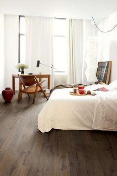 Impressive Ultra Range - This Quickstep laminate range emulates solid wood flooring planks using smart, bevel technology and unique finishes to create seamless edging and an elegant design. In warm, brown tones. Waterproof Laminate Flooring, Wood Laminate Flooring, Solid Wood Flooring, Vinyl Flooring, Quickstep Laminate, Quick Step Flooring, Floor Colors, Bedroom Flooring, Basement Remodeling