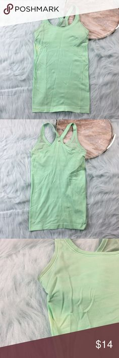 LuLulemon mint green stripe racerback tank LuLulemon mint green tank with light discoloration, please see photo. Size 6, built in bra with cups. No rip tag. lululemon athletica Tops Tank Tops