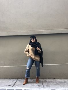Winter fashion chunky knit black scarf paper boy hat cropped flared jeans brown boots outfit