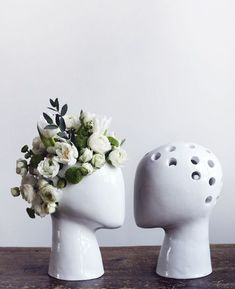 love this vase substitute. the holes help for a perfect arrangement every time AND it's a head! cool!