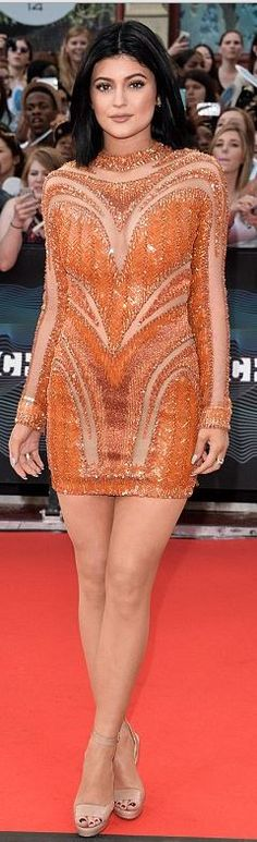 Who made Kylie Jenner�s orange long sleeve dress and nude sandals that she wore in Toronto