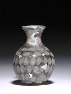 Miniature, opaque, globular glass bottle or unguentarium Late Sasanian 4thC-5thC Asia,Iraq,North Iraq,Kouyunjik