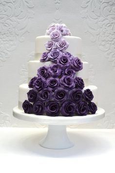 Purple Wedding Cake.. Really really like this. Butter cream roses though. NO fondant. Maybe fade purple to TARDIS blue at the bottom?