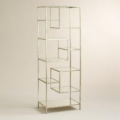 $329 (look for coupons) One of my favorite discoveries at WorldMarket.com: Burnished Metal and Glass Asymmetrical Kali Shelf