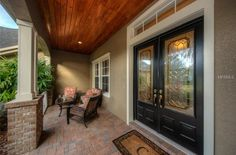 Traditional Front Door with exterior brick floors in Lithia, FL | Zillow Digs