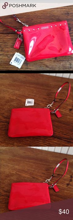"""Coach red wristlet NWOT Coach red wristlet NWOT . This is brand new the tag fell off but will be included. 6"""" across,4.5 high, .5"""" wide. Silver tone hardware. Coach Bags Clutches & Wristlets"""