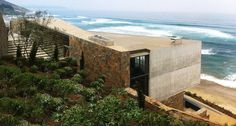 Facing the pacific ocean from a steep dune in beranda, chile, the 'beranda house' by local