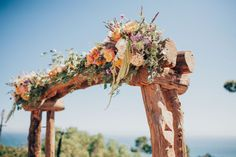 Rustic Wooden Floral Arch at Wedding Ceremony // LVL Weddings & Events // Photography: Tyler Branch Photo // Videography: EK Media Productions // Catering: Above it All Catering // Venue: Private Estate, Rancho Palos Verdes // Rentals: Signature Party Rentals // Floral Design: Green Leaf Designs // Beauty: Design Visage // DJ: Steve Burdick Events // Transportation & Valet: VIP Limousines & Coaches