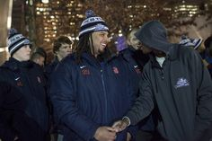 Syracuse defensive tackle Zian Jones laughs as the football team views the 9/11 Memorial. Andrew Renneisen | Staff Photographer.
