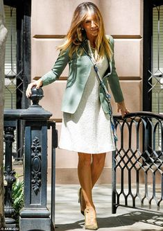 Hitting the town: Sarah Jessica dolled up and emerged from her brownstone looking coiffed and freshly blown out after her motherly duties