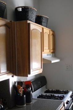 Pimp My Small Kitchen: baskets above cabinets for infrequently used items such as light bulbs | Apartment Therapy