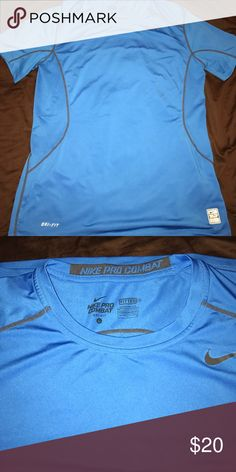 Sky blue Nike pro combat shirt Dri- fit, fitted, compression shirt. Great to work out or be active in. Nike Shirts Tees - Short Sleeve