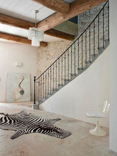 entryway w/ staircase, zebra rug, stone textures, beams, rustic chic Rustic Chic Decor, Eclectic Decor, Rustic Style, Modern Country, Country Chic, Hand Hewn Beams, Wood Beams, Entrance Foyer, Entryway Stairs