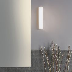 The striking modern design of the Domino LED Bath Light makes it an eye-catching addition to both residential and commercial settings.