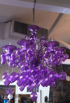 Purple glass chandelier. This is one amazing chandelier. Attracts the attention of everyone that walks into our auction house. Appears to be Italian design, all hand blown.