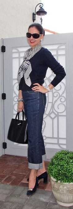 Navy Blue Ralph Lauren Cashmere Cable-Knit Sweater; Ann Taylor Jeans; Oscar by Oscar de la Renta Houdstooth Silk Scarf; Longchamp Rouseau Black Leather Bag; Navy Suede Van-Eli Pumps; Giorgio Armani Sunglasses; and Anne Klein Porcelain Watch. Chic way to update a classic sweater-and-jeans outfit. http://www.akeytothearmoire.com/post/19395272816/earths-laughter