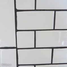 To match our black kitchen appliances, we chose a near-black grout color that contrasted highly with White Tiles Black Grout, White Subway Tile Bathroom, Black Subway Tiles, Subway Tile Showers, Subway Tile In Kitchen, Subway Tile Colors, Tile Grout Colors, White Tile Kitchen, Black And White Backsplash