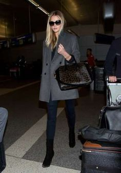 Our absolute favorite part of Rosie Huntington-Whiteley's travel outfit? That gorgeous leopard Given... - Getty
