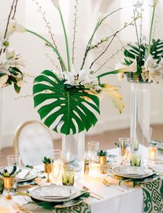 Modern tablescape with palm leaf centerpieces
