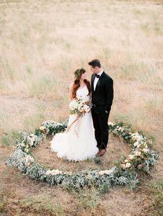 Photography: Leo Patrone - www.leopatronephotography.com Flowers: Sarah Winward, Honey Of A Thousand Flowers - www.sarahwinward.com Wedding Gown: Danielles Bridal Ad Prom - danielles-bridal-slc.com/ Read More on SMP: http://www.stylemepretty.com/2014/12/03/organic-giant-wreath-wedding-inspiration/