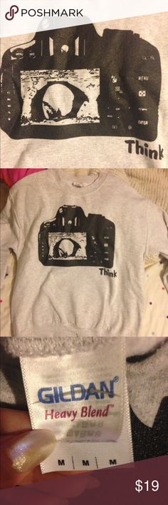 Grey crew neck Perfect for any photographer. Worn a few times and shows no sign of wear. Very warm for cold winter days and also comfortable. It's a size medium. Make me an offer and I'll probably accept if it's reasonable. Also, check out my other items I love to bundle as much as you love to save! Tops Tees - Long Sleeve