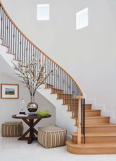 The sweep of this foyer stairway introduces white oak treads and handrails that along with the chunky woven-hemp stools from Annie Selke and metallic vase harmonize natural elements. Florida Design, Moving To Florida, Metal Vase, White Oak, Magazine Design, Stairways, Traditional Design, In This Moment, Interior Design