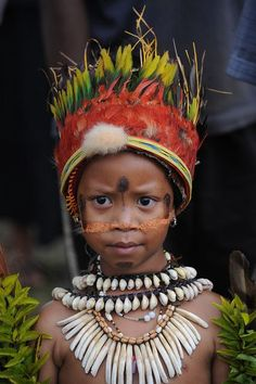 little one from Papua New Guinea (south pf equater, north of Australia, Papua New Guinea is part of a great arc of mountains stretching from Asia, through Indonesia and into the South Pacific and is more than 600 islands and 800 indigenous languages.)