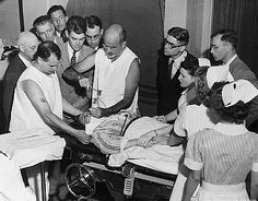 Dr. Walter Freeman performs a lobotomy in 1949 using an instrument he invented.  The pick was inserted under the upper eyelid to cut nerve connections in the frontal lobe.