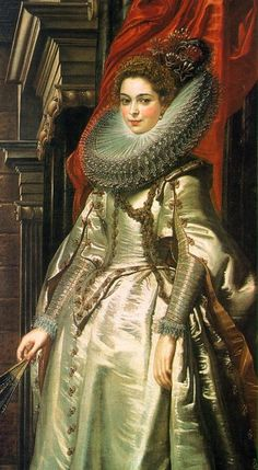 9. Northern Renaissance with lace collar and decorative sleeves also holidng a fan