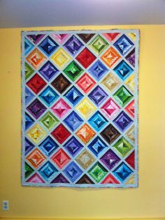 This is a quilt I made for a friend.  It is the most colorful quilt I have made so far.  Summer 2015.