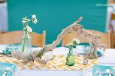 Drift wood table decorations with blue and yellow colours.  Photography by JOIELALA, wedding of Kaci & Tad