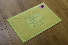"""Translucent envelopes allowed me to add the sunburst logo on the back of the """"Additional information card"""" and using tone-on-tone colors meant that the yellow type wouldn't interfere with writing on the envelope."""