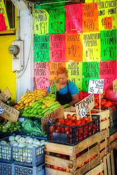 A produce vendor at Mercado Los Globos, the largest open-air market in Ensenada, Mexico.