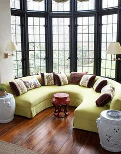 horseshoe banquette ~ Markham Roberts designed it for the bay window and covered it in a fresh, bright green, Brasilia (in Anis) by Manuel Canovas. Traditional House, Traditional Design, Living Room Designs, Living Spaces, House Ideas, Boho Home, Living Room Windows, Window Design, My Dream Home