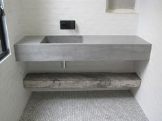 stone sink with white tiles