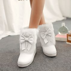 27.53$  Buy here - http://aixxi.worlditems.win/all/product.php?id=32499881027 - Hot autumn and winter 2014 fashion female models cute bow round wild snow boots Martin boots short boots XY103