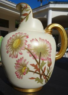 Royal Worcester Porcelain Flat Back Jug or Pitcher. Hand pianted large white daisies with pink tips and yellow center on green stems asccompanied with small buds. Circa 1888