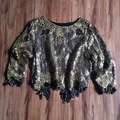 Vintage sequin top Vintage sequin top! Beautiful gold sequins and beading. Fun leaf cut detail around arms and waist. Fair condition. There is a slight tare in the fabric on back shoulder. It's vertical and not very noticeable. The top is lined and tare is only on top layer. Because of vintage condition there are some beads and sequins missing here and there but overall intact. Size M but fits more small-medium. Vintage Tops Blouses