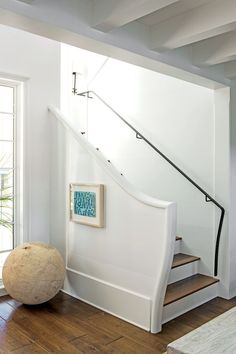 To encourage people to flow forward through the house, Ken de-emphasized the stairs, tucking them off to the side.