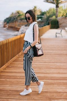 striped pants with loose top and sneakers