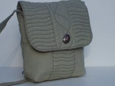 *Flap-over with magnetic snap closure covers the front pocket as well as the main compartment  *Full width zippered pocket on the back side  *Interior