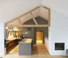 grey kitchen, 3/4  natural wood beams