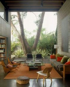 Floor to ceiling seamless window to the backyard. . Now that's a focal point