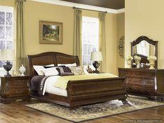 sleigh bed master bedroom warm neutrals dark wood guest